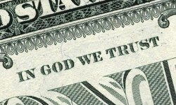 close up of in god we trust on dollar bill